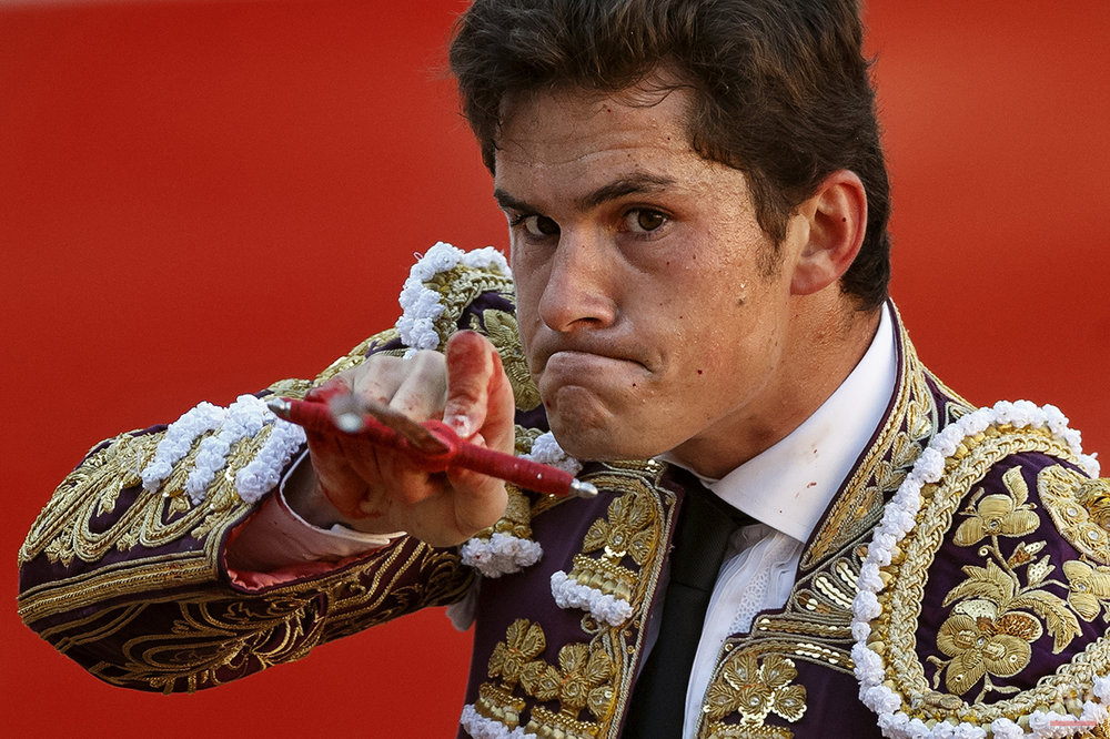 "Spanish bullfighter Daniel Luque aims his sword before killing a bull during a bullfight of the San Fermin festival, in Pamplona, Spain, Monday, July 7, 2014. Revelers from around the world arrive in Pamplona every year to take part on some of the eight days of the running of the bulls glorified by Ernest Hemingway's 1926 novel ""The Sun Also Rises."" (AP Photo/Daniel Ochoa de Olza)"