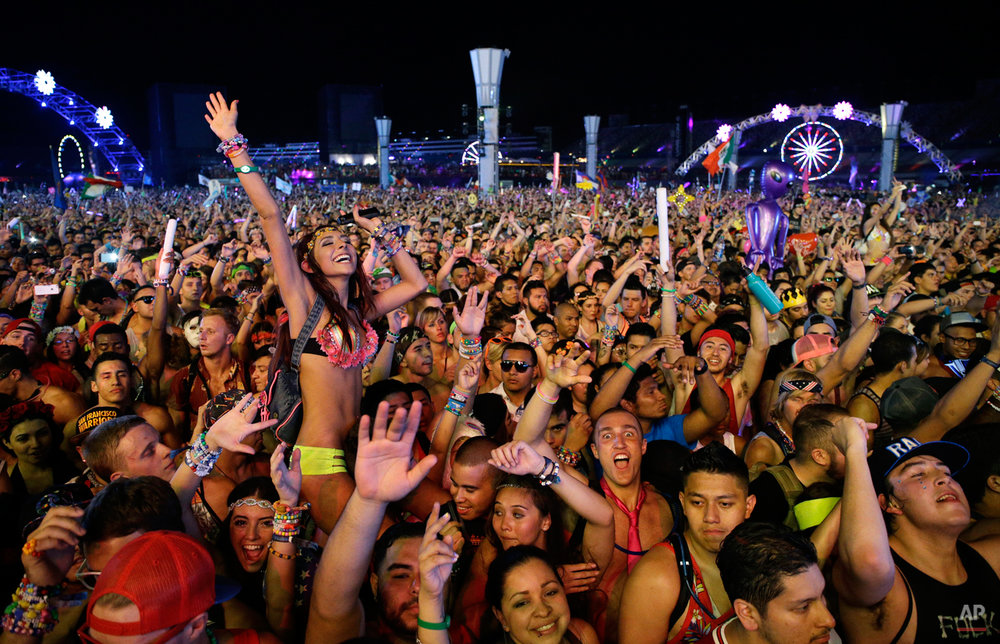 Carnival goers dance to music by Krewella at the Electric Daisy Carnival, Saturday, June 21, 2014, in Las Vegas. The festival sold over 130,000 tickets per night to the three-day ode to electronic dance music held at the Las Vegas Motor Speedway. (AP Photo/John Locher)