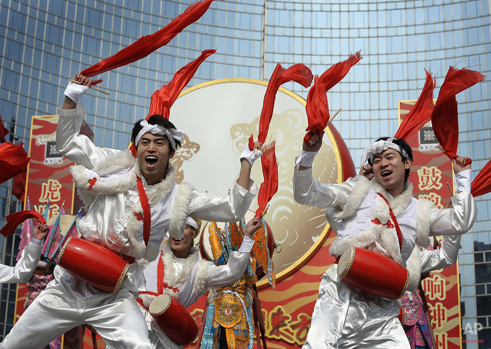 A group of artist from Shanxi province perform drum dance outside an office buildings on the 9th day of the Lunar New Year celebrations in Beijing, Monday, Feb. 22, 2010. Millions of Chinese are returning to work or study when the week-long Spring Festival holiday draws to an end on Friday. (AP Photo/Andy Wong)
