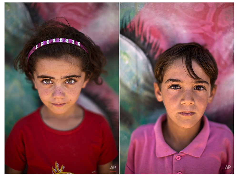 In this Tuesday, July 29, 2014 combo photo, Syrian refugee Samah, 5, and Ahmad, 6, pose for a picture at Zaatari refugee camp, near the Syrian border, in Mafraq, Jordan. (AP Photo/Muhammed Muheisen)