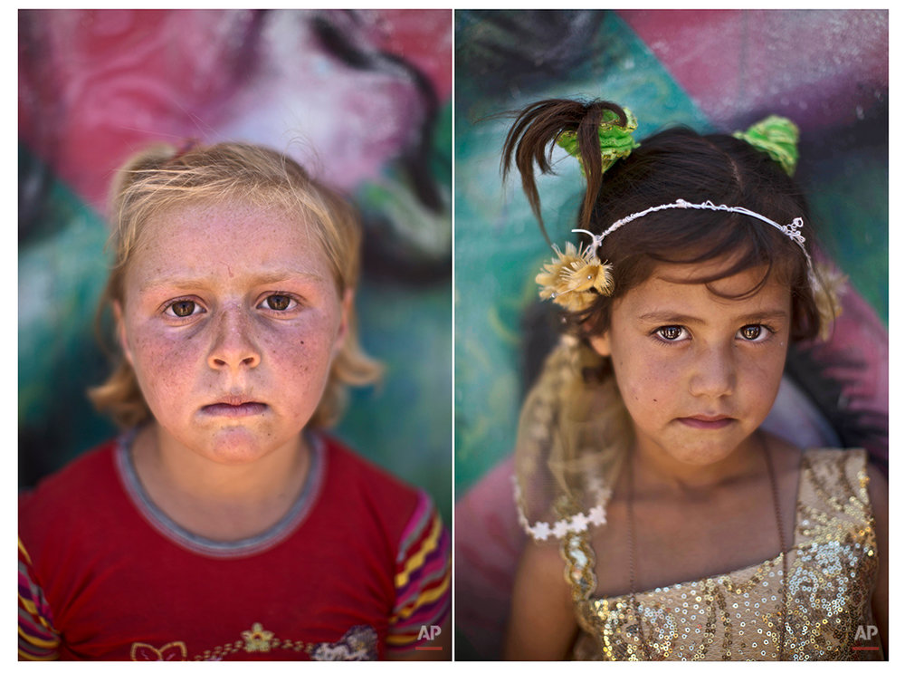 In this Tuesday, July 29, 2014 combo photo, Syrian refugee Malak, 9, and Batoul, 6, pose for a picture at Zaatari refugee camp, near the Syrian border, in Mafraq, Jordan. (AP Photo/Muhammed Muheisen)