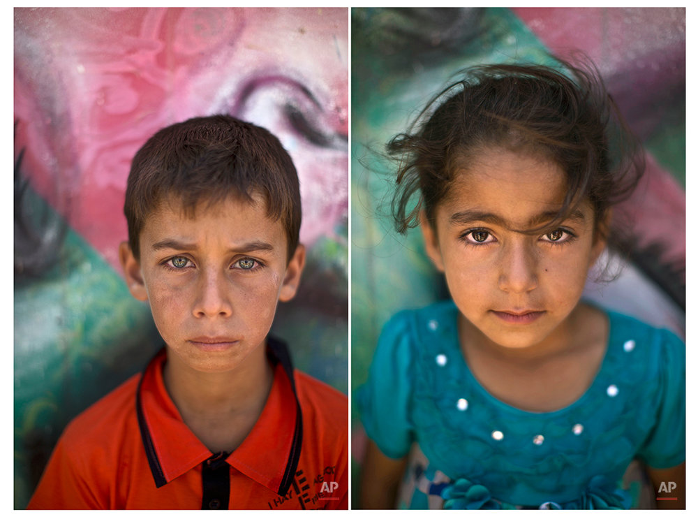 In this Tuesday, July 29, 2014 combo photo, Syrian refugee Mohammed, 12, and Zainab, 5, pose for a picture at Zaatari refugee camp, near the Syrian border, in Mafraq, Jordan. (AP Photo/Muhammed Muheisen)
