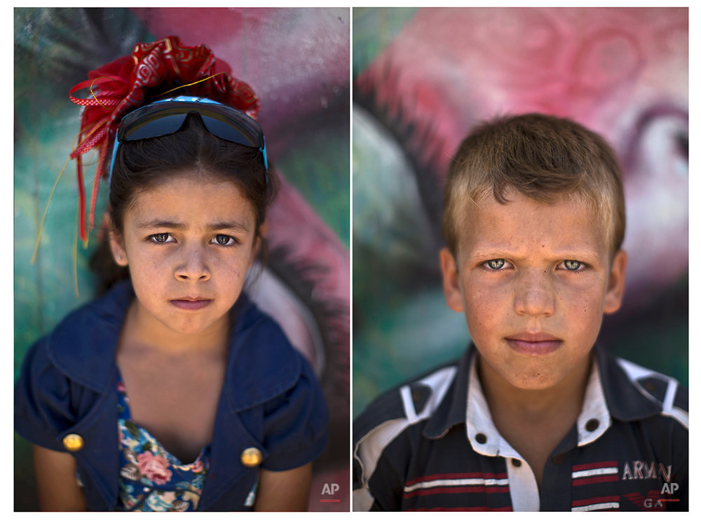 In this Tuesday, July 29, 2014 combo photo, Syrian refugee Jood, 8, and Ammar, 10, pose for a picture at Zaatari refugee camp, near the Syrian border, in Mafraq, Jordan. (AP Photo/Muhammed Muheisen)