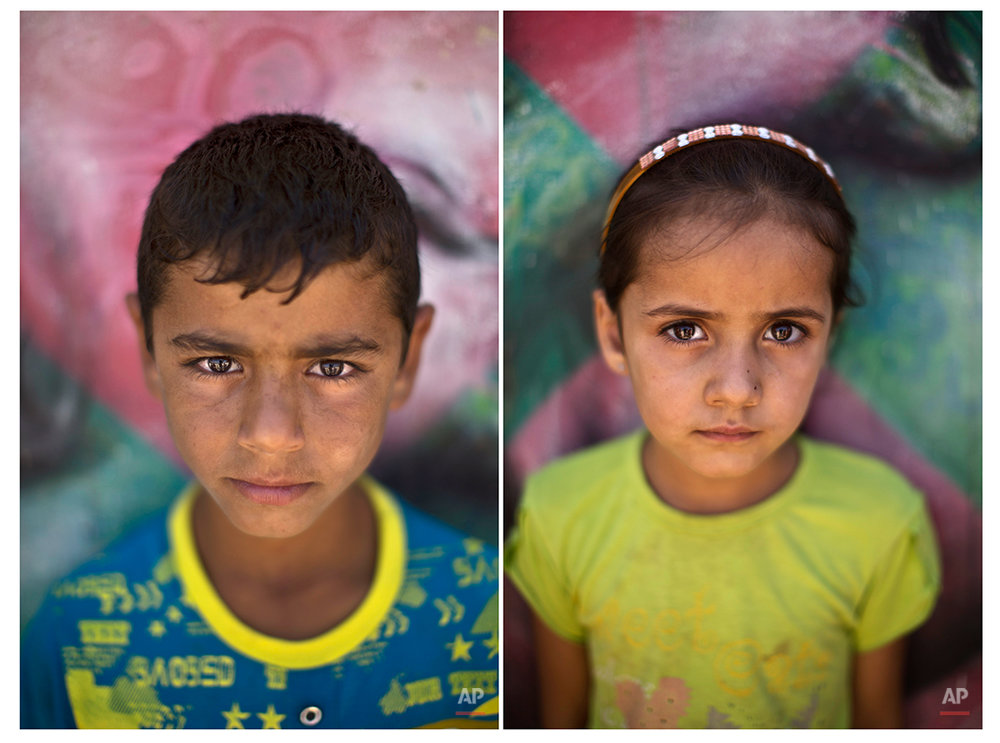 In this Tuesday, July 29, 2014 combo photo, Syrian refugee Hatem, 13, and Boran, 5, pose for a picture at Zaatari refugee camp, near the Syrian border, in Mafraq, Jordan. (AP Photo/Muhammed Muheisen)