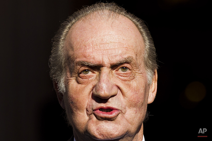 In this Tuesday, Dec. 27, 2011, file photo Spain's King Juan Carlos leaves after the official opening of the Parliament, in Madrid. Spain's King Juan Carlos plans to abdicate and pave the way for his son, Crown Prince Felipe, to take over, Spanish Prime Minister Mariano Rajoy told the country Monday in an announcement broadcast nationwide. The 76-year-old Juan Carlos oversaw his country's transition from dictatorship to democracy but has had repeated health problems in recent years. (AP Photo/Daniel Ochoa de Olza)