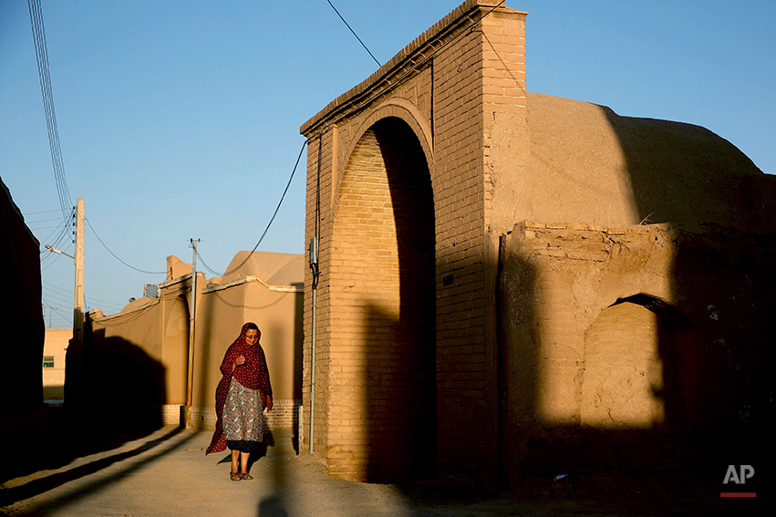 In this Friday, June 13, 2014 photo, a Zoroastrian woman makes her way after performing prayers at a temple in Ardakan, 330 miles (550 kilometers) southeast of the capital Tehran, Iran. Zoroastrianism is a monotheistic religion predating Christianity, Islam and Judaism, founded some 3,800 years ago by the prophet Zoroaster. It was the dominant religion in Persia before the Arab conquest. (AP Photo/Ebrahim Noroozi)