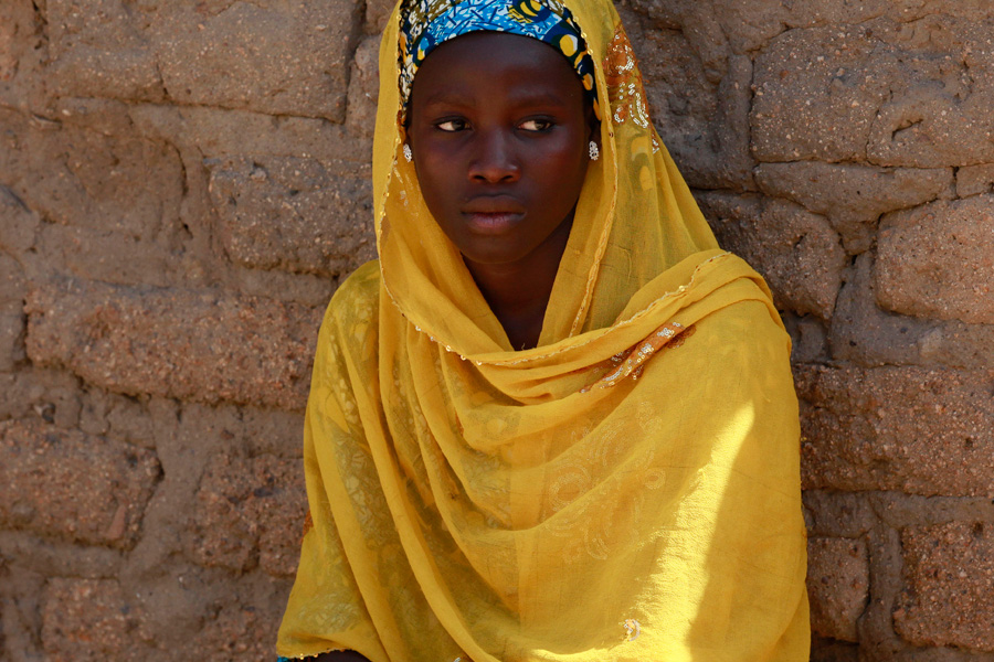 In this photo taken Sunday, May 18, 2014, Joy Bishara, one of the school girls that escaped being kidnapped by Islamist extremists by jumping off a truck, is photographed outside her home, in Chibok, Nigeria. More than 200 schoolgirls were kidnapped from a school in Chibok in Nigeria's north-eastern state of Borno on April 14. Boko Haram claimed responsibility for the act. (AP Photo/Sunday Alamba)