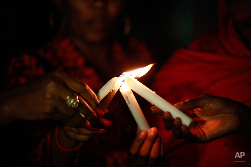 People light candles during a vigil to mark one month after the girls of government secondary school Chibok were kidnapped, in Abuja, Nigeria, Wednesday, May 14, 2014. Nigeria's government is ruling out an exchange of more than 270 kidnapped schoolgirls for detained Islamic militants, Britain's top official for Africa said Wednesday. Boko Haram abducted more than 300 schoolgirls from the school in Chibok in the northeastern state of Borno on April 15. (AP Photo/Sunday Alamba)