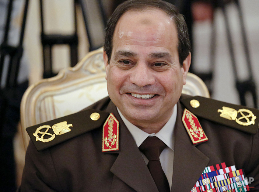 In this Thursday, Feb. 13, 2014 file photo, Egypt's military chief Field Marshal Abdel-Fattah el-Sissi smiles as he speaks to Russian Foreign Minister Sergey Lavrov during their talks in Moscow, Russia. The election of Egypt's former military chief to the nation's presidency may be remembered for its central irony: He won in a historic landslide — only to shatter his image of invulnerability in the process. El-Sissi's win was never in doubt, but what the retired 59-year-old field marshal wanted was an overwhelming turnout that would accord legitimacy to his July ouster of Egypt's first freely elected president — the Islamist Mohammed Morsi — and show critics at home and abroad that his action reflected the will of the people. (AP Photo/Alexander Zemlianichenko)