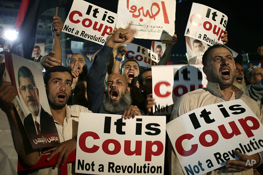 In this July 28, 2013 file photo supporters of Egypt's ousted President Mohammed Morsi chant slogans against Egyptian Defense Minister Gen. Abdel-Fattah el-Sissi at Nasr City, in Cairo, Egypt. El-Sissi removed Morsi on July 3, 2013 after protests by millions demanding that the Islamist leader go. After much deliberation, Washington decided not to declare it a coup, a step that would have required a cut-off in U.S. aid. El-Sissi, as Egypt's likely next president is confident that a strong showing in Egypt's elections May 26-27, 2014, will prove that Egyptians wanted his ouster of the country's Islamist president, which threw relations between the two allies into their worst strains ever. (AP Photo/Hassan Ammar)