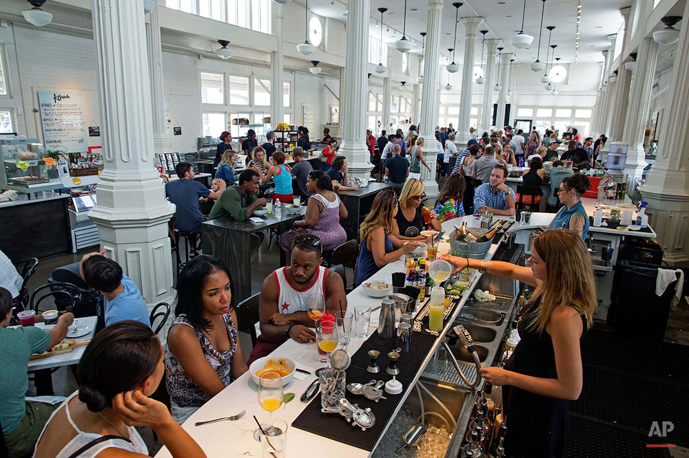 Crowds gather for Sunday brunch at the newly renovated St. Roch market in New Orleans, Sunday, Aug. 16, 2015. Helped by billions of dollars in recovery money, buoyed by volunteers and driven by the grit of its own citizens, New Orleans has rebounded in ways few thought possible in the ten years after Hurricane Katrina. (AP Photo/Max Becherer)