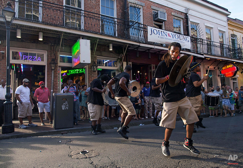 A percussion band performs for tourist dollars on Bourbon Street in the French Quarter of New Orleans, Saturday, Aug. 15, 2015. New Orleans is nearly three centuries old, mixing African-American, French, Spanish and Caribbean traditions to create unique forms of music, food and culture found nowhere else in America. (AP Photo/Max Becherer)