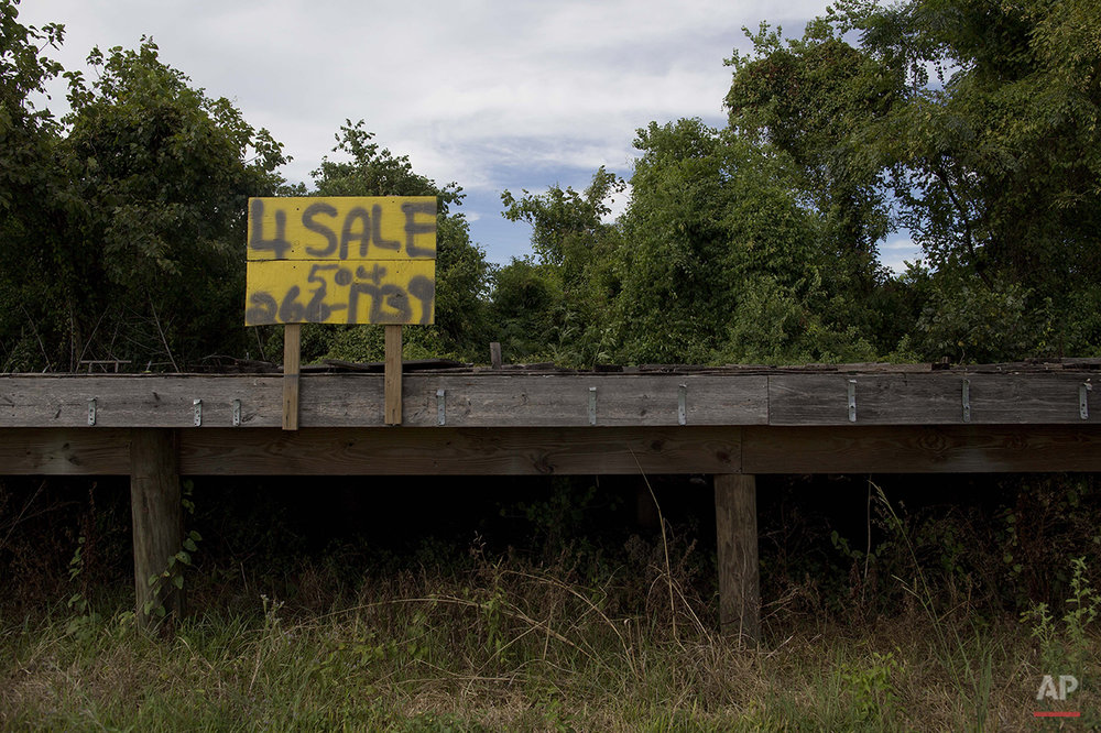 "The remnants of a home destroyed by Hurricane Katrina sits on a lot for sale on Deslonde Street in the Lower 9th Ward of New Orleans, Monday, Aug. 17, 2015. People who talk about a renaissance in the city speak in the same breath about those didn't recover. The ""New"" New Orleans is whiter and more expensive to live in. African-American neighborhoods across the city still struggle, especially the chronically neglected Lower 9th Ward, a center of black home ownership before the floodwalls failed. And the murder rate is rising again. (AP Photo/Max Becherer)"