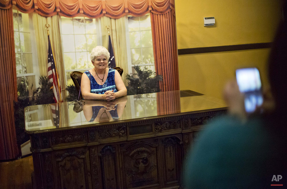 "Jane Gurley, of Hendersonville, N.C., has her photo taken at a mock Oval Office while visiting the hometown of former President Jimmy Carter in Plains, Ga., Saturday, Aug. 22, 2015. ""He was the first President I voted for,"" said Gurley. ""It has special meaning."" (AP Photo/David Goldman)"