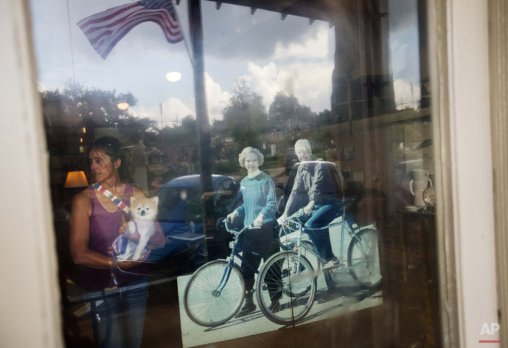 A visitor walks near a cutout of former President Jimmy Carter and his wife, Rosalynn, at an antique mall in Carter's hometown of Plains, Ga., Sunday, Aug. 23, 2015. Residents of Plains say they're grateful that Carter has never forgotten his hometown. He and his wife, Rosalynn, have always kept a home in Plains, but the 90-year-old Carter intends to spend a lot more time in the tiny town as he's treated for cancer that has spread to his brain. (AP Photo/David Goldman)