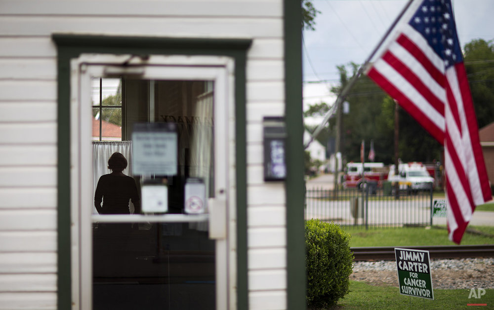 A visitor walks through an old train depot that became a local campaign office for former President Jimmy Carter in his hometown in Plains, Ga., Sunday, Aug. 23, 2015. Carter's 1976 election to the presidency made Plains a tourist destination. Main Street stores are stocked with Carter memorabilia and peanut souvenirs. (AP Photo/David Goldman)