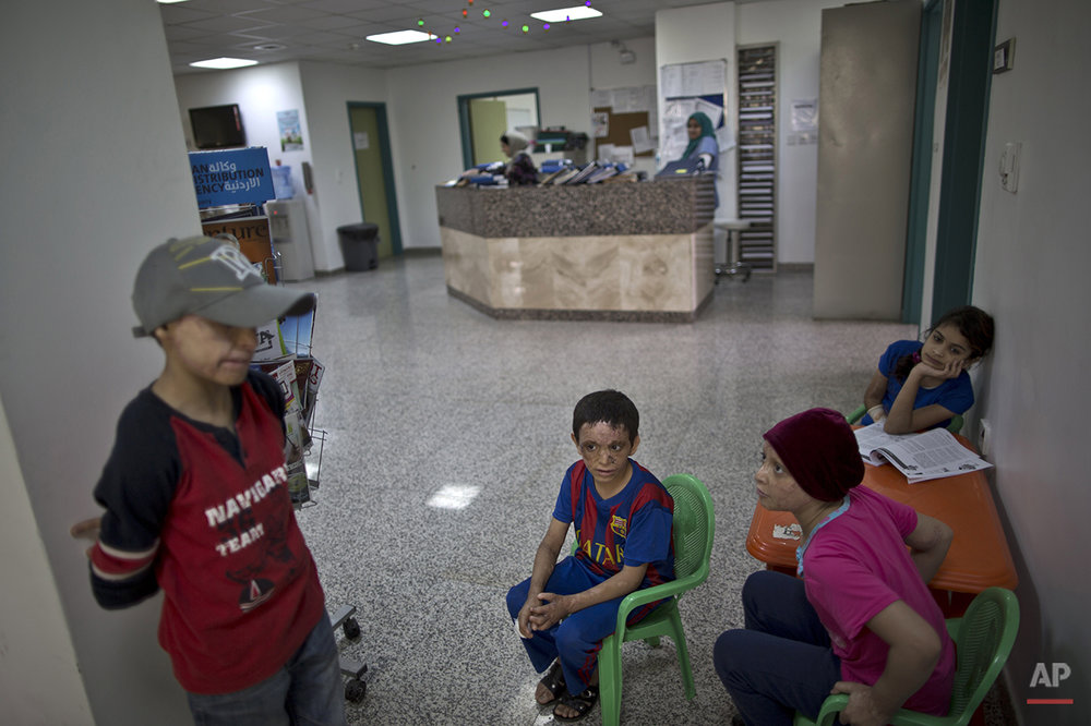 In this Monday, Aug. 17, 2015 photo, a group of patients wait for their turn to be checked by a doctor at MSF Hospital for Specialized Reconstructive Surgery, run by the international charity Médecins Sans Frontières (Doctors Without Borders) in Amman, Jordan. The hospital MSF has a capacity of 200 _ it's at 180 children and adults currently _ and the need is immense. In Syria alone, more than 1 million have been wounded in the war since 2011, the World Health Organization recently estimated. (AP Photo/Muhammed Muheisen)