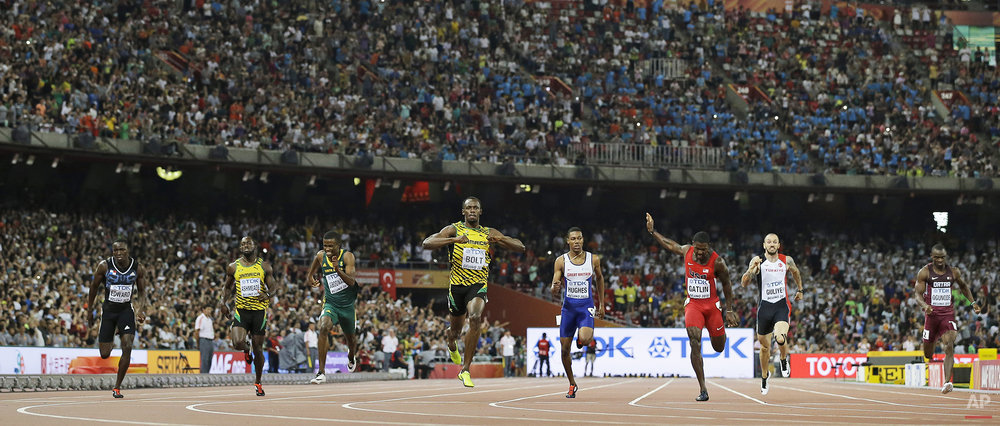 Jamaica's Usain Bolt, middle, celebrates after winning the men's 200m final at the World Athletics Championships at the Bird's Nest stadium in Beijing, Thursday, Aug. 27, 2015. (AP Photo/David J. Phillip)