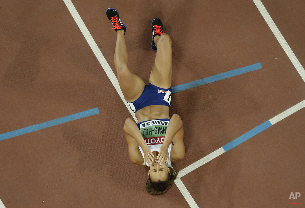 Gold medalist Britain's Jessica Ennis-Hill celebrates after the heptathlon 800m at the World Athletics Championships at the Bird's Nest stadium in Beijing, Sunday, Aug. 23, 2015. (AP Photo/Wong Maye-E)
