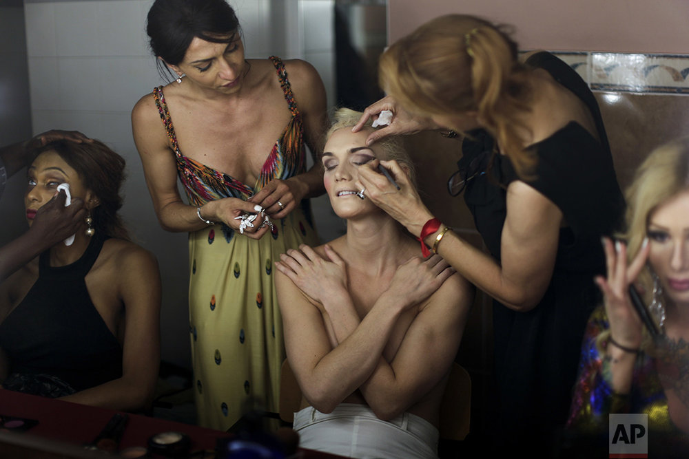 In this Sunday, Sept. 18, 2016 photo, Linni Rows Wiman, from Sweden, is made up by friends ahead of the Miss Trans Star International 2016 celebrated in Barcelona, Spain. (AP Photo/Emilio Morenatti)