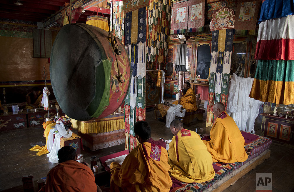 In this Aug. 18, 2016, photo, Buddhist monks perform their daily rituals in the monastery of Komic in Spiti Valley, India.  (AP Photo/Thomas Cytrynowicz)