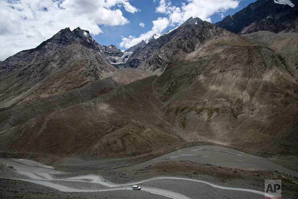 In this Aug. 15, 2016, photo, a jeep drives along the only road that leads to Spiti Valley, a remote Himalayan valley situated at 4000 meter above sea level, India. (AP Photo/Thomas Cytrynowicz)