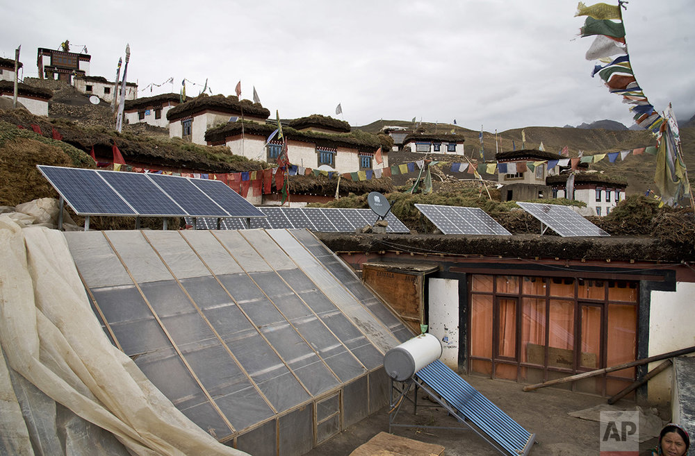 In this Aug. 17, 2016, photo, solar panels are installed on the rooftop of a traditional house in the mountain village of Demul, Spiti Valley, India. (AP Photo/Thomas Cytrynowicz)