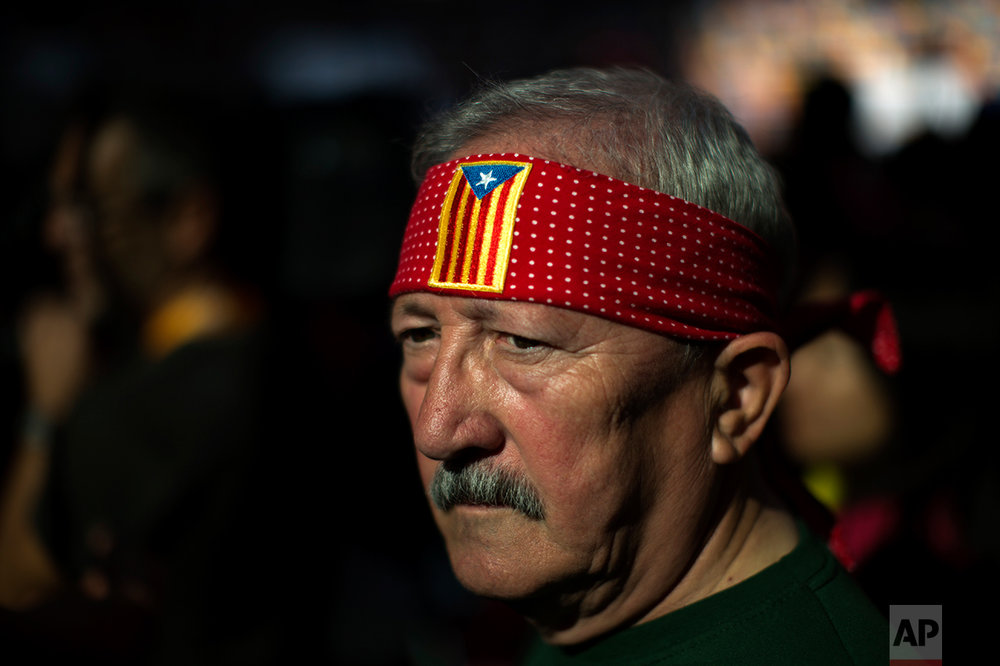 In this Saturday, Oct. 1, 2016 photo, Antoni Guasch, 66, pauses before taking part in an human tower during the 26th Human Tower Competition in Tarragona, Spain. (AP Photo/Emilio Morenatti)