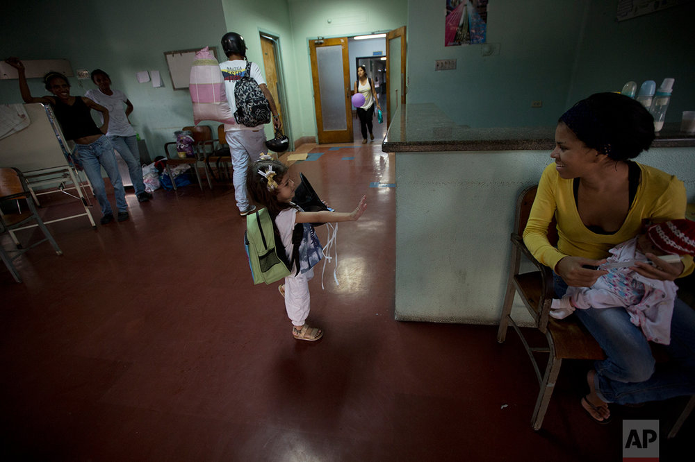 "In this Sept. 19, 2016 photo, 3-year-old Ashley Pacheco waves goodbye after she was discharged from University Hospital in Caracas, Venezuela. ""I really don't know of any other country where things have deteriorated so quickly, to such an incredible extent,"" said Rafael Perez-Escamilla, a Yale University School of Public Health professor who has worked in Latin America and Africa. ""Venezuela's health system was a model for Latin America. Now you are seeing an implosion where people cannot get basic care."" (AP Photo/Fernando Llano)"