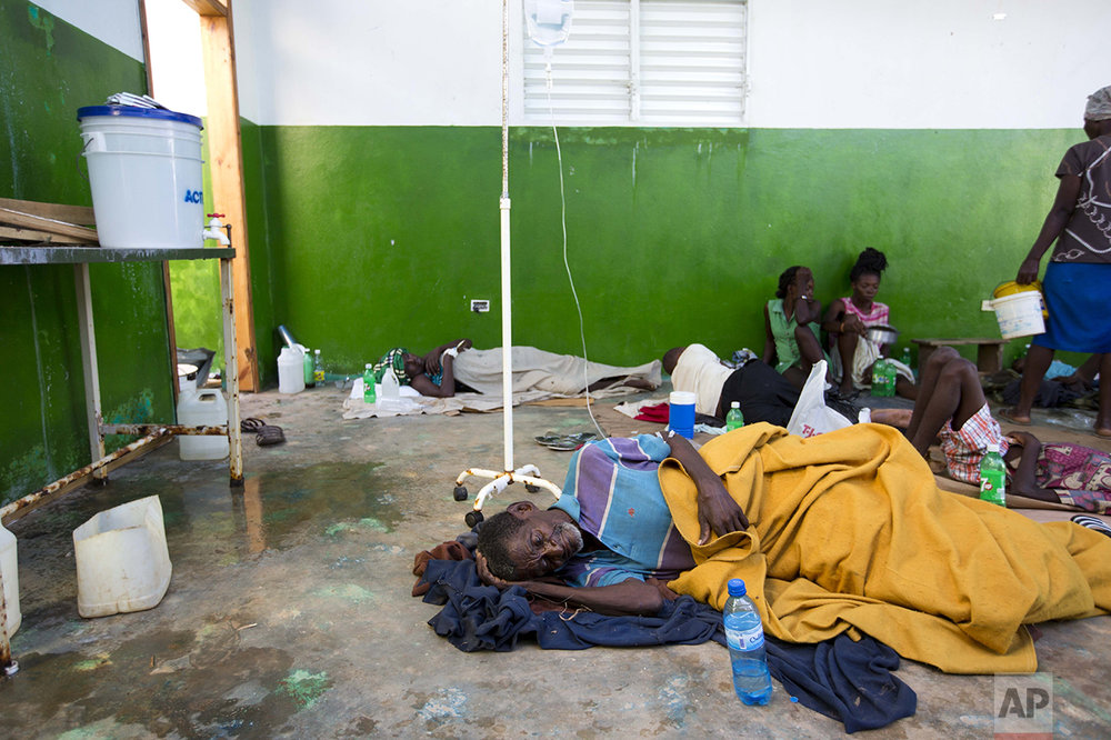"Victims of cholera receive treatment at a cholera center in Anse D'Hainault, Haiti, Tuesday, Oct. 11, 2016. The U.N. said Hurricane Matthew has increased the risk of a ""renewed spike"" in the number of cholera cases. (AP Photo/Dieu Nalio Chery)"