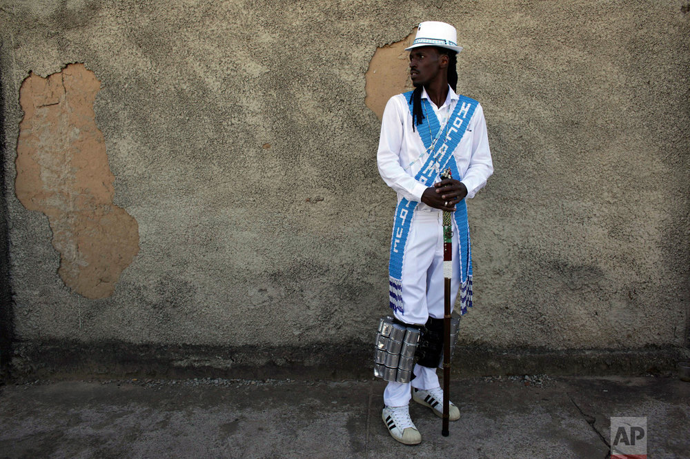 This Oct. 9, 2016 photo shows Leonardo Barbosa, captain of the Mozambique Sacred Heart of Mary brotherhood, during the annual Afro-Christian Congada celebration in Catalao, Goias state, Brazil. The brotherhoods are groups comprised of African-Brazilian families who organize the annual celebration as a way to maintain their ties to African religious traditions.  (AP Photo/Eraldo Peres)