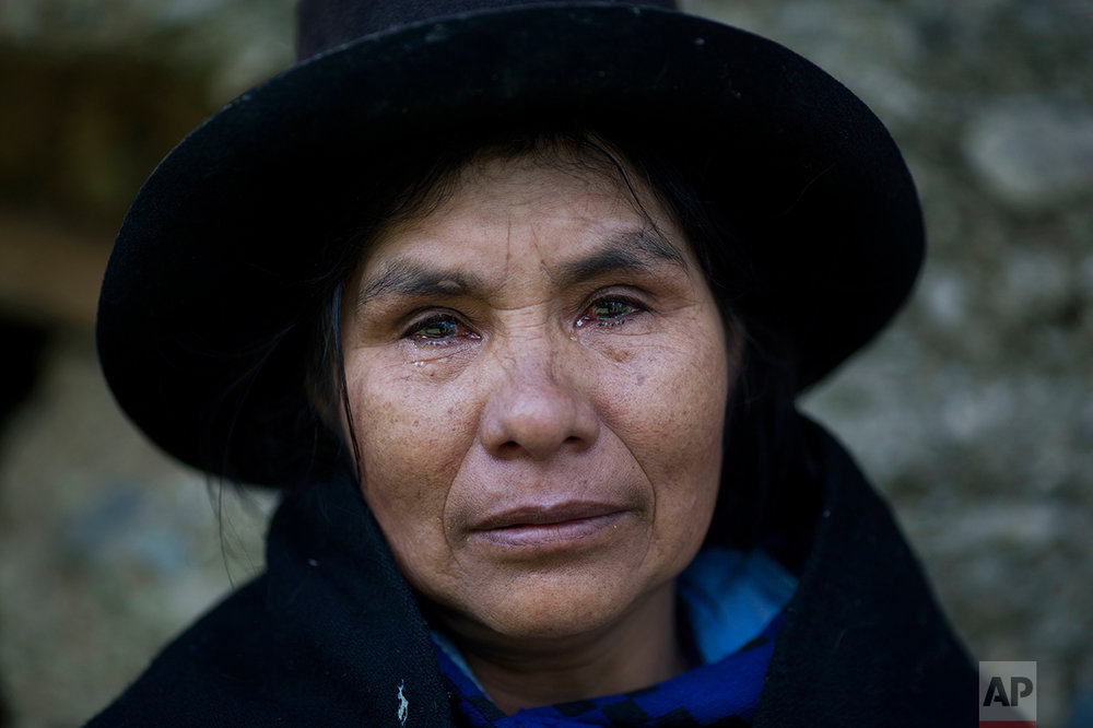 This June 16, 2013 photo shows Eudicia Urbano, 70, in front of her former home near the spot where her husband Marcial Escalante died, weeping as she retells how he was tortured and killed by Shining Path rebels, in Chaca, Peru. The region endured some of the worst atrocities of Peru's 1980-2000 conflict, in which both Maoist-inspired insurgents and security forces committed grave human rights violations. (AP Photo/Rodrigo Abd)