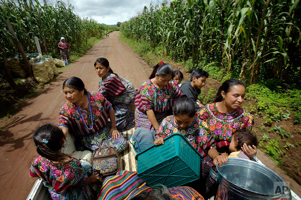 In this Sept. 2, 2008 photo, rural midwife Francisca Raquec, 65, second from left, returns home after shopping at the market in Patzun, Guatemala. In Guatemala, rural midwives deliver six of every ten babies, and the government plans to train 15,000 of them to reduce the number of women who die from child birth. (AP Photo/Rodrigo Abd)