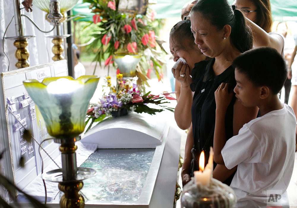 In this Sept. 14, 2016 photo, Betty Soriano Romero, the mother of alleged drug user Marcelo Salvador, grieve during funeral rites at their house in Las Pinas, south of Manila, Philippines. Drug dealers and drug addicts, were being shot by police or slain by unidentified gunmen in mysterious, gangland-style murders that were taking place at night. Salvador became a victim, the casualty of a vicious war on drugs that has claimed thousands of lives as part of a campaign by Philippine President Rodrigo Duterte. (AP Photo/Aaron Favila)