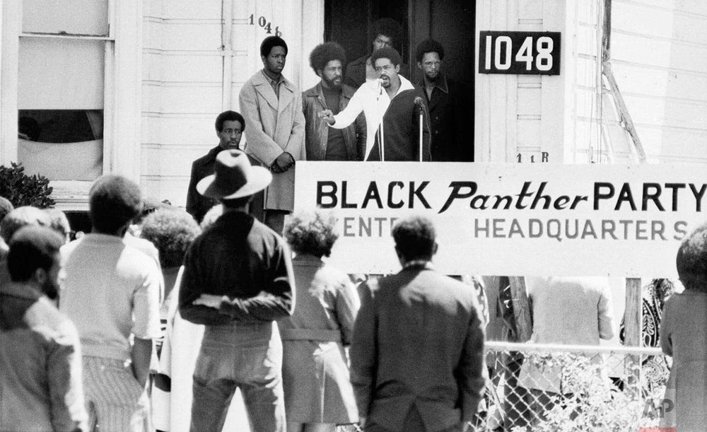 In this Aug. 13, 1971 photo, Bobby Seale, chairman of the Black Panther Party, addresses a rally outside the party headquarters in Oakland, Calif., urging members to boycott certain liquor stores. Hundreds of former Black Panthers from around the world are expected to gather in Oakland, California, for a four-day conference that started Thursday, Oct. 20, 2016. The Panthers emerged from the gritty city 50 years ago, declaring a new party dedicated to defending African-Americans against police brutality and protecting their rights. (AP Photo)