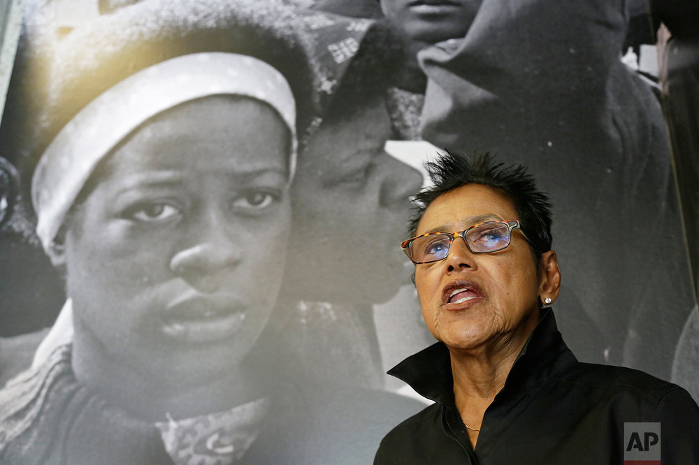 In this photo taken Saturday, Oct. 8, 2016, former Black Panther Party leader Elaine Brown answers questions outside a museum in Oakland, Calif. Hundreds of former Black Panthers from around the world are expected to gather in Oakland, Calif., for a four-day conference that started Thursday, Oct. 20, 2016. The Panthers emerged from the gritty city 50 years ago, declaring a new party dedicated to defending African-Americans against police brutality and protecting their rights. (AP Photo/Eric Risberg)