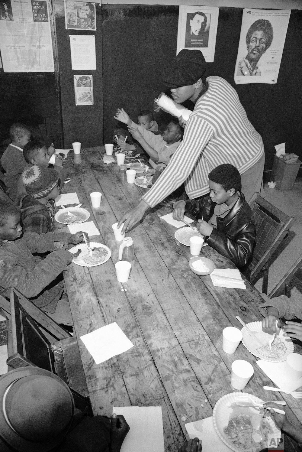 Brad Jones, wearing cap, member of the Philadelphia Black Panthers Organization, helps serve breakfast to youngsters, March 19, 1970 in Philadelphia, Pa., headquarters. (AP Photo/Bill Ingraham)