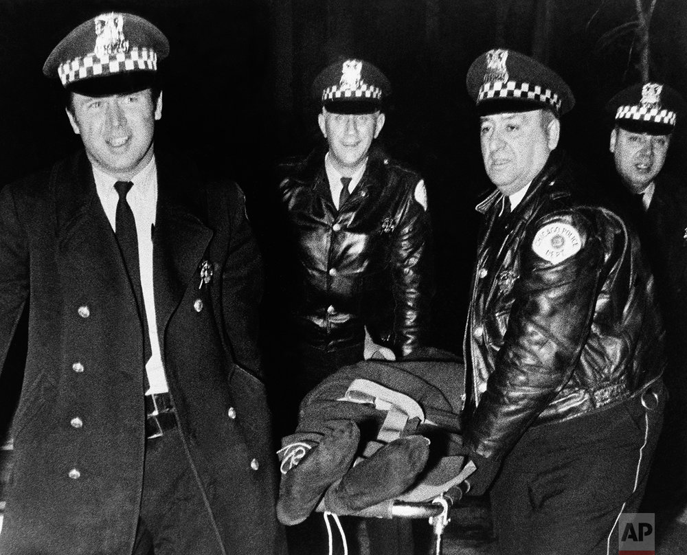 Chicago police remove the body of Fred Hampton, leader of the Illinois Black Panther Party, who was slain in a gun battle with police on Chicago's west side Dec. 4, 1969. Shooting erupted as police arrived at the building next to the Black Panther offices to serve a warrant. Another man identified as Mark Clark of Peoria, Ill., was killed and seven others wounded. (AP Photo)