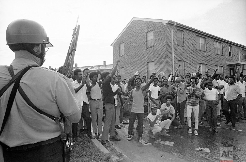 Police occupy the Black Panther headquarters in New Orleans following a shootout on Tuesday, Sept. 16, 1970. Seven persons were wounded and 14 others were arrested during the incident. (AP Photo)