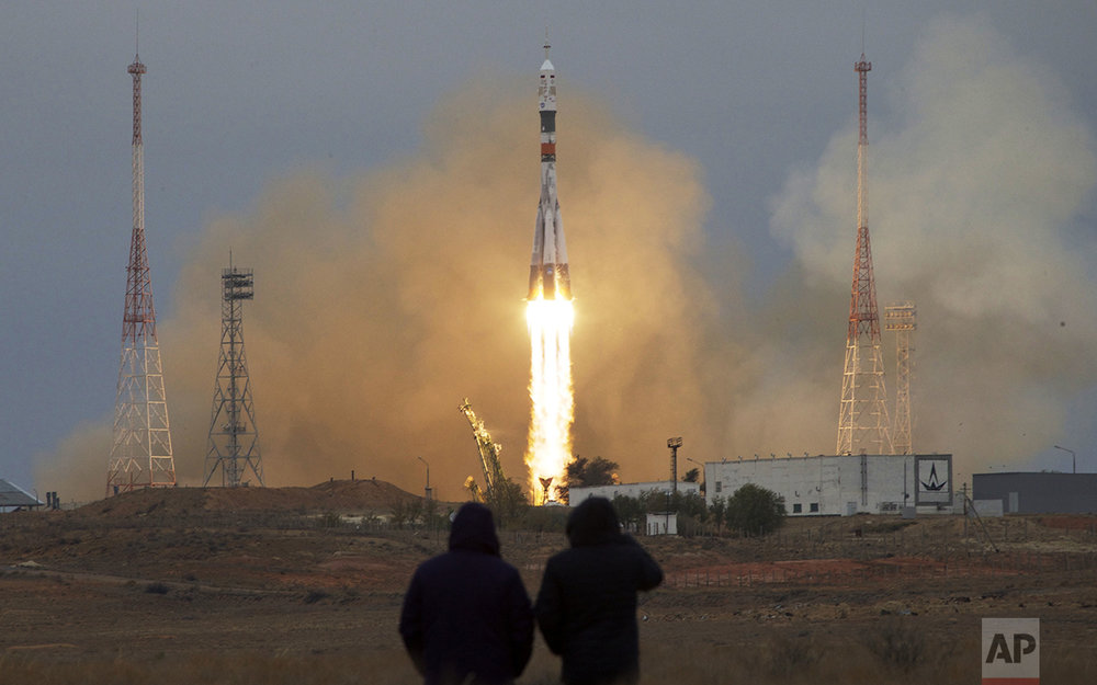A Soyuz rocket booster with a MS-02 spaceship carrying a new crew to the International Space Station launches from the Russian-leased Baikonur cosmodrome in Kazakhstan, on Wednesday, Oct. 19, 2016. The Russian rocket carries U.S. astronaut Shane Kimbrough, and Russian cosmonauts Sergey Ryzhikov and Andrey Borisenko. (AP Photo/Ivan Sekretarev)