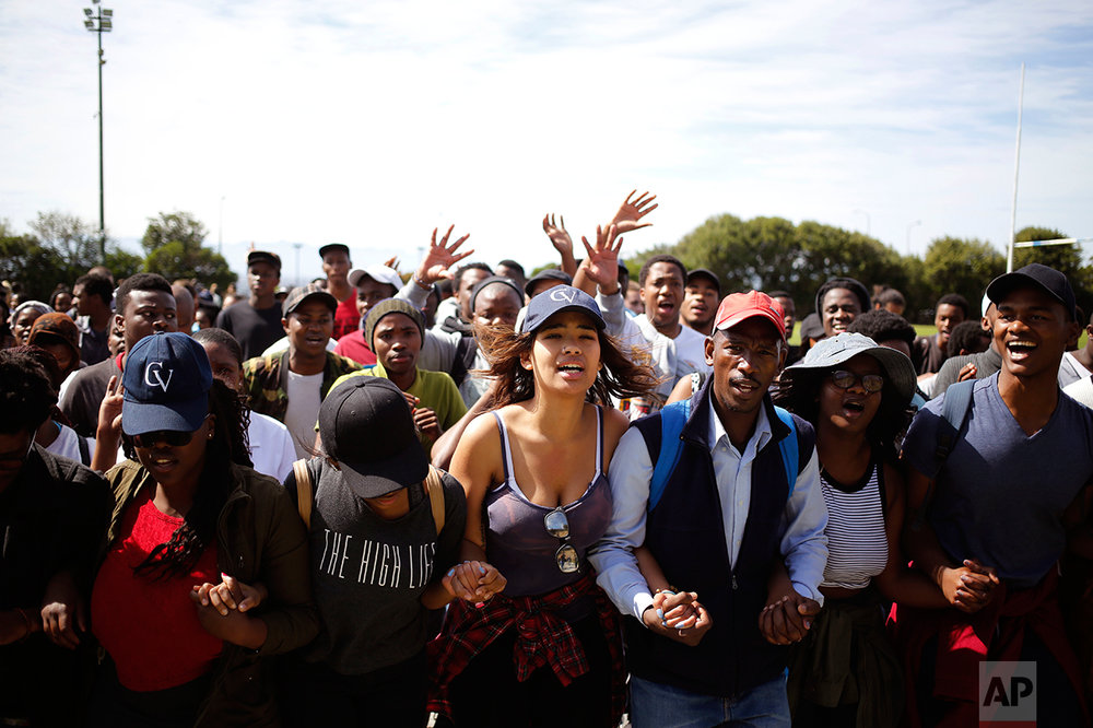Students chant and sing at the University of Cape town as they protest for free education in Cape Town, South Africa, Tuesday, Sept. 20, 2016. (AP Photo/Schalk van Zuydam)
