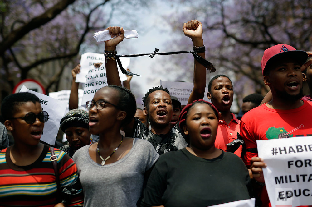 Students demonstrate downtown Pretoria, South Africa, Thursday, Oct. 20, 2016. A group of 200 were granted a last minute permission to walk to the Union Building. Protests calling for free education have at times turned violent, and affected many South African universities since last month. (AP Photo/Jerome Delay)