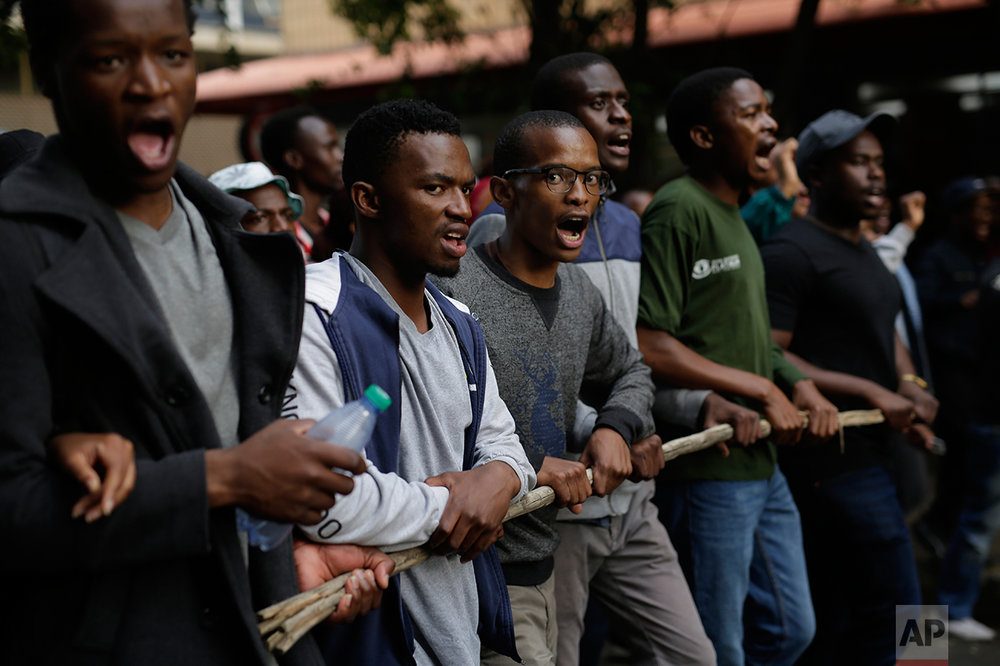Students from the University of the Witwatersrand march Wednesday, Oct. 19, 2016 through downtown Johannesburg, South Africa. Protests calling for free education have sometimes turned violent and have roiled many South African universities since last month. (AP Photo/Jerome Delay)