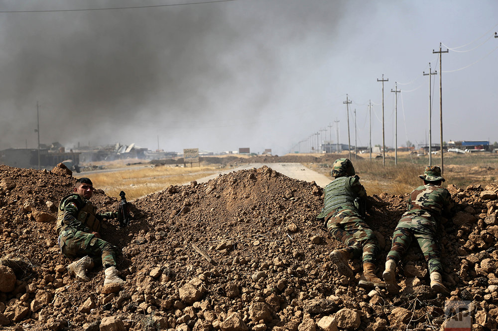 Kurdish security forces take up a position as they fight overlooking the Islamic State-controlled in villages surrounding Mosul, in Khazer, about 30 kilometers (19 miles) east of Mosul, Iraq, Monday, Oct. 17, 2016. Iraqi government and Kurdish forces, backed by U.S.-led coalition air and ground support, launched coordinated military operations early on Monday as the long-awaited fight to wrest the northern city of Mosul from Islamic State fighters got underway. (AP Photo)