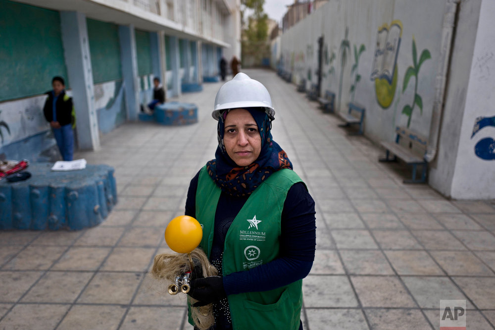 In this Monday, March 21, 2016 photo, Jordanian plumber Maryam Mutlaq, 41, poses for a picture at a school in Zarqa, northeast of Amman. Mutlaq's choice of career is rare for the Arab world where traditional gender roles make men the main breadwinners and confine most women to certain jobs - teachers, nurses, low-level government clerks. Five years ago, the Arab Spring brought the hope of more opportunities for women. Yet that promise has not panned out, analysts and activists say, and in some cases spreading violence has even led to a backlash. (AP Photo/Muhammed Muheisen)