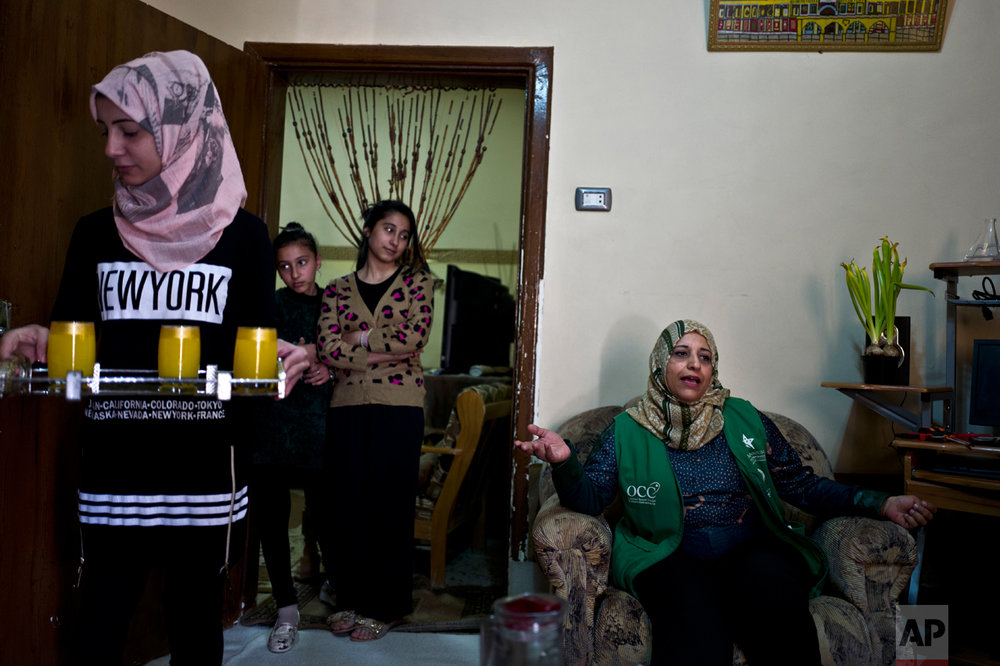 Jordanian plumber Maryam Mutlaq, 41, at her home in Zarqa, northeast of Amman, Jordan, Tuesday, March 1, 2016. (AP Photo/Muhammed Muheisen)