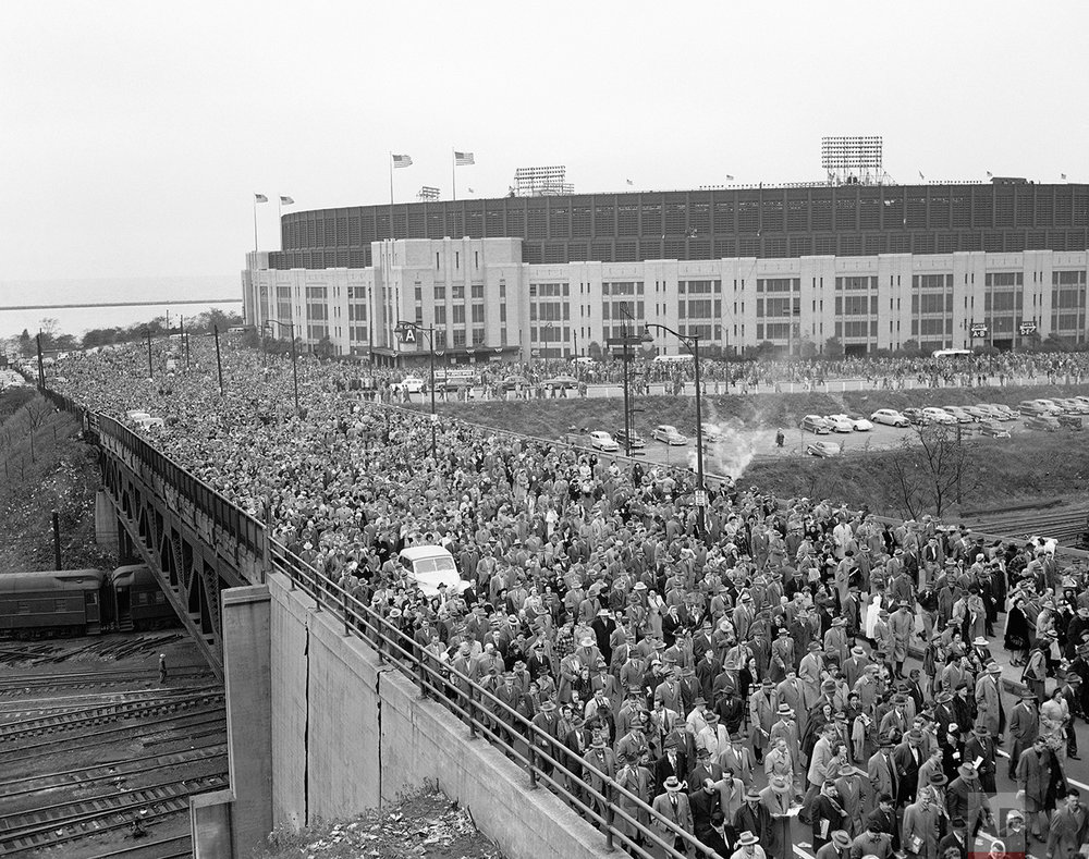 A crowd of 86,288 persons in Cleveland, OH, the largest ever in baseball history, makes its way across a railroad bridge from the Municipal Stadium after the fifth game of the 1948 World Series between the Cleveland Indians and Boston Braves on October 10, 1948, in Cleveland. Automobiles were lost in the mob. Boston won, 11-5. (AP Photo)