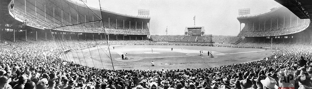 This Oct. 10, 1948, photo, shows a view of Municipal Stadium in Cleveland as the largest crowd in baseball history, 86,288 persons, watched Game 5 of the 1948 World Series between the Boston Braves and the Cleveland Indians. The Indians defeated the Braves 4-3 in Game 6 on Oct. 11, 1948. The Indians would go on to win three more American League pennants but not another World Series championship. (AP Photo)