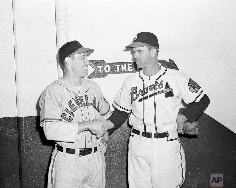 Johnny Sain, right, of the Boston Braves, shakes hands with Cleveland's Bob Feller, before the two hurling aces took mound, Oct. 6, 1948 at Braves Field, Boston, for the opening game of the 1948 World Series. (AP Photo)