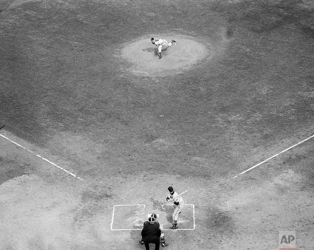 Lefthander Warren Spahn throws the first ball in the second game of the 1948 world series at Braves Field Oct. 7, 1948. Leadoff batter for Cleveland is left fielder Dale Mitchell. Braves catcher is Bill Salkeld and calling play is umpire Bill Summers. Mitchell fouled off the first pitch. (AP Photo)